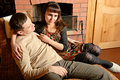 Free Young Couple Near Fireplace Stock Images - 8544864