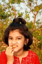 Free Girl Taking A Bite Royalty Free Stock Image - 8548596