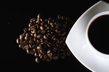 A White Cup Of Coffee And Coffee Beans Royalty Free Stock Photo