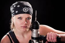 Free Severe Young Woman With A Drill Stock Photo - 8544810