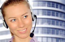 Free Woman Wearing Headset In Office;could Be Reception Stock Photo - 8549960