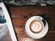 Free White Ceramic Cup Of Latte Beside White Newspaper Stock Photo - 85405150