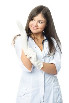 Free Doctor Putting On Sterile Rubber Gloves Stock Image - 8551511