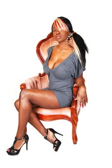 Jamaican Women In Armchair. Royalty Free Stock Photography