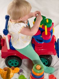 Free Child Sits On Toy Stock Images - 8554644