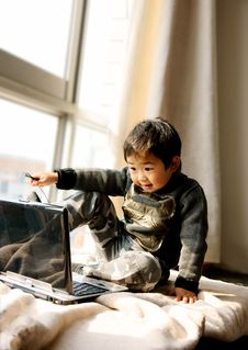 Boy Playing With Notebook Stock Image