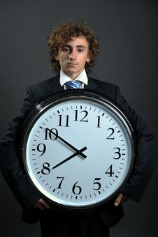 Free Businessman With Clock Royalty Free Stock Photography - 8556597