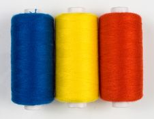 Three Colored Sewing Spools Stock Photography