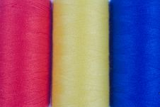 Three Colored Sewing Spools Stock Image