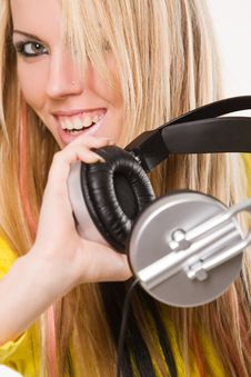 Attractive Young Woman With Headphones Over White Royalty Free Stock Photos