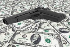 Free US Dollars With Gun Stock Images - 8557894