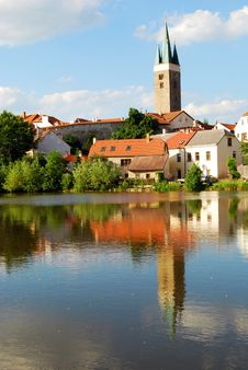 Free Tower And Houses With Lake Reflection Royalty Free Stock Image - 8561436