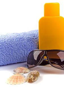 Towel, Sunglasses And Lotion Stock Images