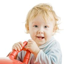 Kid With A Toy Stock Photography
