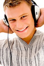 Free Smiling Handsome Male Listening To Music Stock Images - 8573184