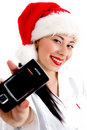 Free Woman Wearing Christmas Hat And Showing Mobile Royalty Free Stock Image - 8573796