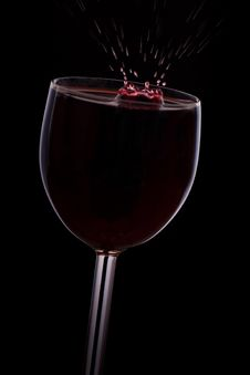 A Drop Of Red Wine Falls Into The Glass Royalty Free Stock Photo