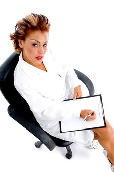 Free Sitting Doctor With Notepad And Pen Stock Photo - 8574280
