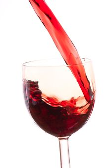 Pour The Wine Into The Glass On A White Background Royalty Free Stock Photo