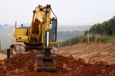 Free Excavator Digging Up Some Ground And Rocks 3 Stock Photography - 8578362