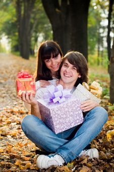 Young Couple With Gift Boxes Stock Photos
