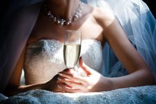 Bride With Glass Of Champagne In The Limo Stock Images