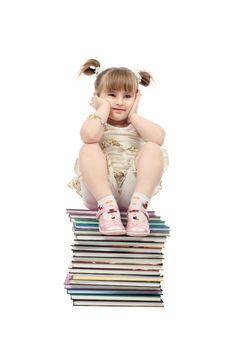 Free Sitting On Books Royalty Free Stock Image - 8583366