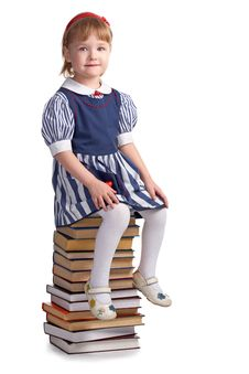 Free Schoolgirl Sitting On The Heap Of Books Royalty Free Stock Photos - 8585268