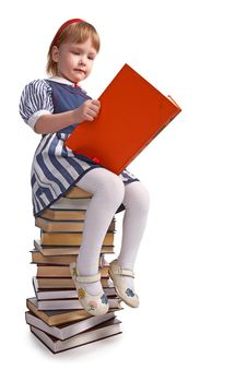 Free Schoolgirl Sitting On The Heap Of Books Royalty Free Stock Images - 8585279