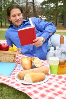 Free Young Caucasian Male Reading Book Outdoor Stock Photography - 8588872