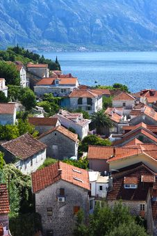 Free Top View Of Red Tiled Roofs And Courtyards In A Small Town In Montenegro, Tourists Stock Photos - 85825813