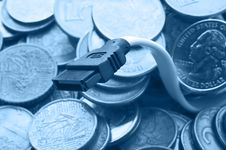Free Sata Computer Cord And Pile Of Coins Stock Photo - 8595340