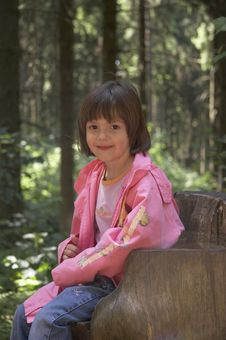 Free Girl Sitting On A Tree Stump 03 Stock Image - 863341