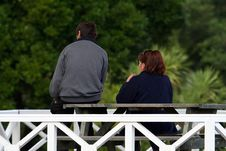 Man And Woman On A Bench Royalty Free Stock Images