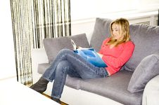 Free Reading On Her Sofa Royalty Free Stock Photos - 8602458