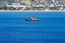 Free Orange Boat In Blue Water Stock Photos - 8602733