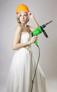 Free Girl In Evening Dress With A Drill Stock Photos - 8606633
