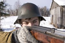 Free Red Army Soldier Aims From A Rifle Royalty Free Stock Image - 8606886