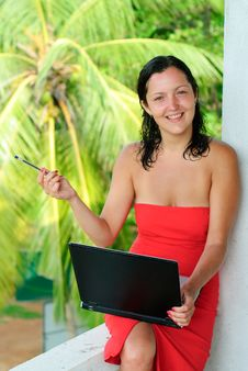 Smiling Beautiful Young Woman With Laptop Stock Photo