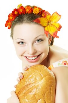 Smiling Girl With A Great Bread Royalty Free Stock Photography