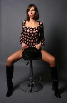 Free Girl Sitting On A Chair Stock Photography - 8617052