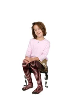 Free Young Girl In Funky Outfit Sitting On Stool Stock Images - 8618094