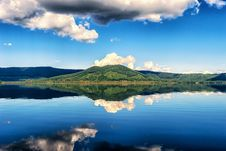 Free Clouds Reflecting On Blue Lake Stock Photos - 86184423