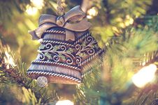 Free Brown Black Floral Carve Bell Hanging On A Christmas Tree Stock Image - 86185481