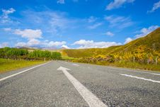 Free Road Passing Through Landscape Against Blue Sky Stock Photography - 86187702