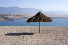Free Sun Umbrella On Empty Beach Royalty Free Stock Photo - 8622255