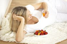 Young Pretty Pregnant Woman With Strawberries Royalty Free Stock Photography