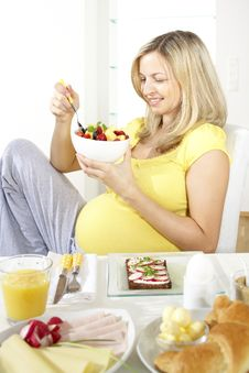 Pregnant Woman Eats Fruit Salad Royalty Free Stock Photo