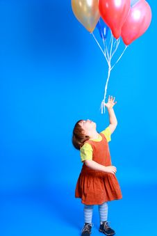 Free Little Girl Holding Balloons Stock Photography - 8629362
