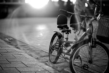 Free Tandem Bicycle On Sidewalk In Greyscale Photography Stock Photography - 86220582